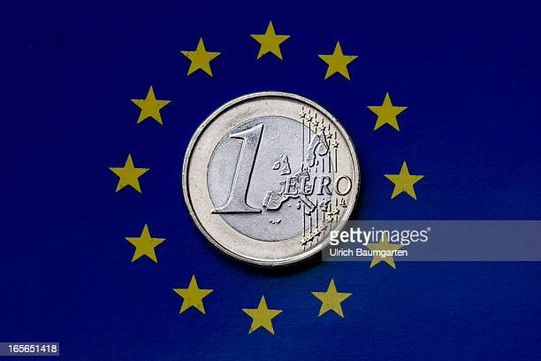 In this photo illustration a one Euro coin is displayed on the flag of Europe the emblem of the European Union on March 28 2013 in Bonn Germany...