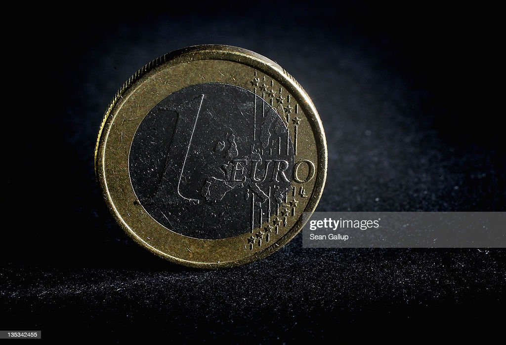 In this photo illustration a one Euro coin stands illuminated on December 9, 2011 in Berlin, Germany. Leaders of the European Union convended in Brussels the day before in an effort to finalize joint measures to stabilize the Euro amidst speculation that the common currency can no longer survive in its current form.