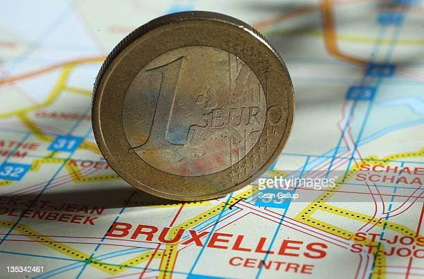 In this photo illustration a one Euro coin stands on a map of Brussels on December 9 2011 in Berlin Germany Leaders of the European Union convended...
