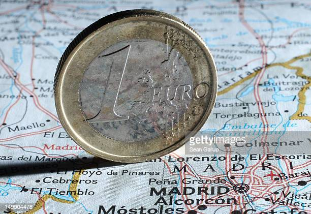 In this photo illustration a one Euro coin stands on a map of Spain next to Madrid on August 6 2012 in Berlin Germany The Spanish government is...
