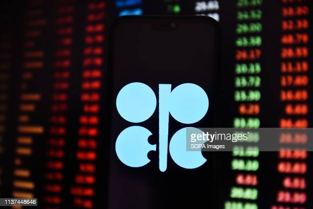 In this photo illustration a OPEC logo seen displayed on a smart phone