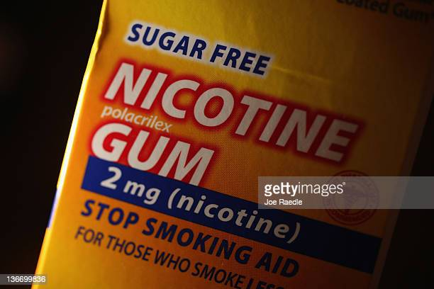 In this photo illustration a package of Nicotine Gum which is advertised as helping people stop smoking cigarettes is seen on January 10 2012 in...