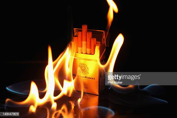In this photo illustration a packet of cigarettes is pictured alight on April 27 2012 in Auckland New Zealand Associate Health Minister and Maori...