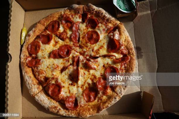 In this photo illustration a Papa John's pizza is seen on July 11 2018 in Miami Florida The founder of Papa John's pizza John Schnatter apologized...