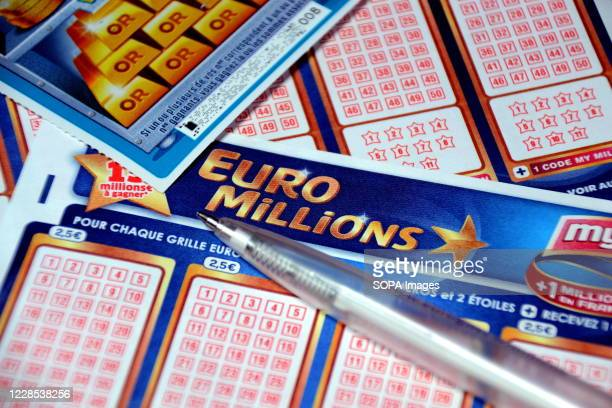 In this photo illustration a pen and a scratch card on Euromillions tickets. A couple from Alsace pocketed the 157 million euros of the Euromillions...