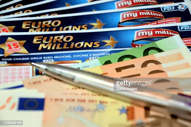 In this photo illustration a pen and euros banknotes on Euromillions tickets. A couple from Alsace pocketed the 157 million euros of the Euromillions...