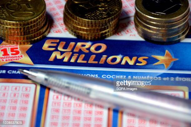 In this photo illustration a pen and euros coins on Euromillions tickets. A couple from Alsace pocketed the 157 million euros of the Euromillions...