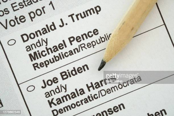 In this photo illustration a pencil lies on a U.S. Presidential election mail-in ballot received by a U.S. Citizen living abroad that shows current...