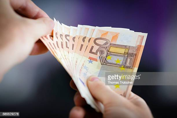 In this Photo Illustration a person holds Euro banknotes on August 03 2016 in Berlin Germany