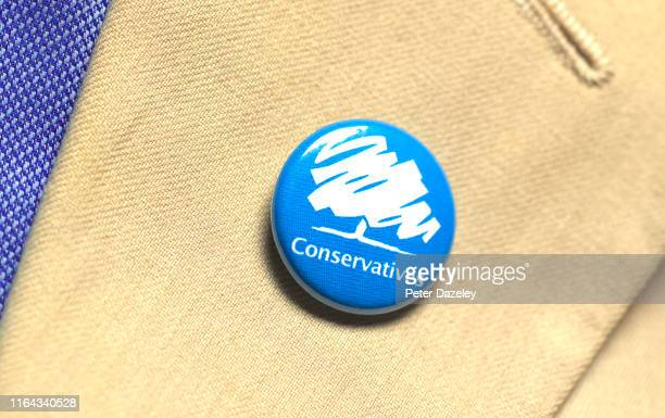 In this photo illustration, a person wears a Conservative Party badge photographed July 18, 2019 in London.