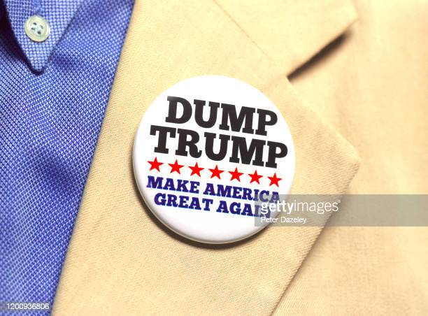 In this photo illustration a person wears a Dump Trump button badge on January 21,2020 in London,England.