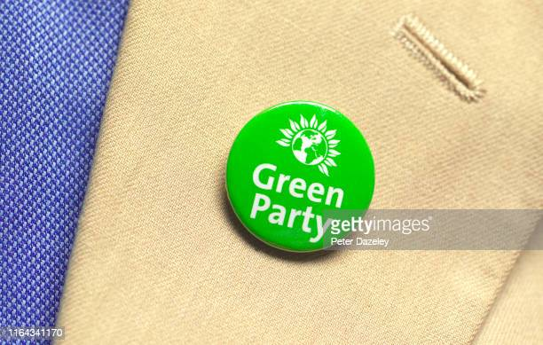 In this photo illustration a person wears a Green Party badge photographed July 18 2019 in London
