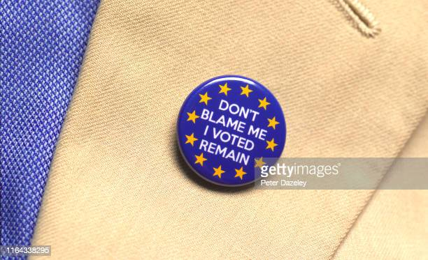 In this photo illustration a person wears a Remain EU badge photographed July 18 2019 in London