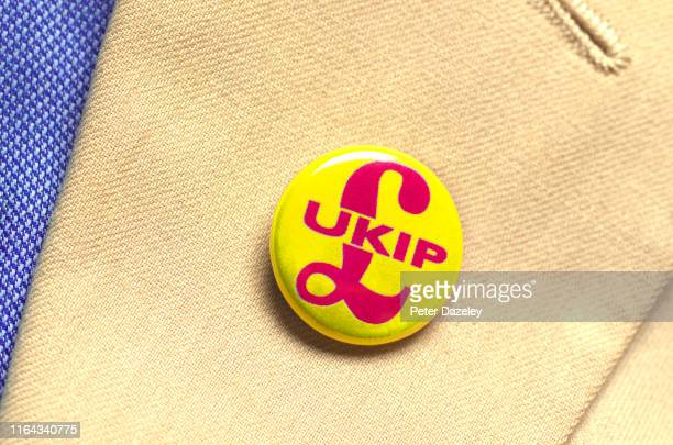 In this photo illustration a person wears a UKIP Party badge photographed July 18 2019 in London