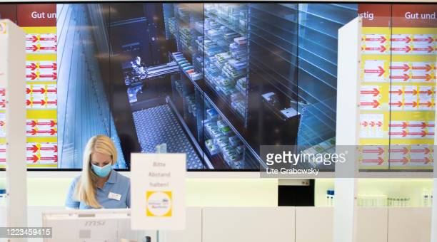 In this photo illustration a pharmacist is standen in front of a picking machine on June 12 2020 in Bonn Germany