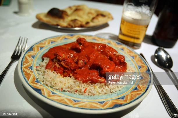 In this photo illustration a plate of Chicken Tikka Masala is displayed in a curry restaurant in Brick Lane on February 13 2008 in London Curry...