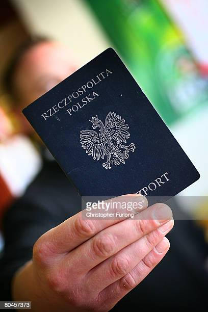 In this photo illustration a Polish worker displays his passport on 1 April Crewe England Crewe in Cheshire has one of Britain's biggest communities...