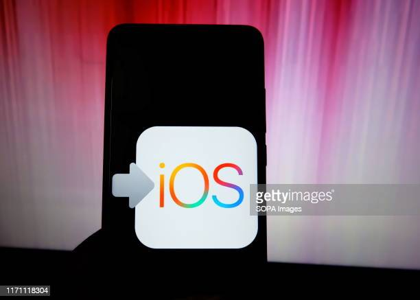 In this photo illustration a popular location operating system of Apple Phone IOS logo seen displayed on a smartphone