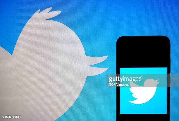 In this photo illustration a popular micro blogging and social networking service Twitter logo seen displayed on a smartphone