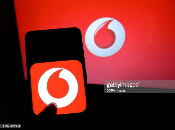 In this photo illustration a popular mobile operator Vodafone logo seen displayed on a smartphone.