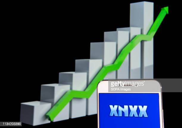 In this photo illustration a pornographic video sharing and viewing websites Xnxx logo is seen on an android mobile device with an ascent growth...