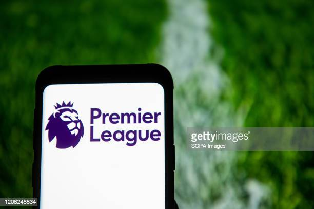In this photo illustration a Premier League logo seen displayed on a smartphone.