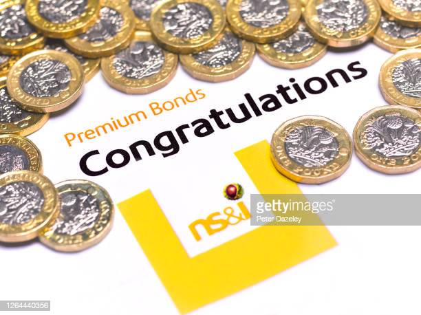 In this photo illustration, a Premium Bond congratulatory note and pound coins on August 7,2020 in London,England. Premium Bonds are a lottery bond...