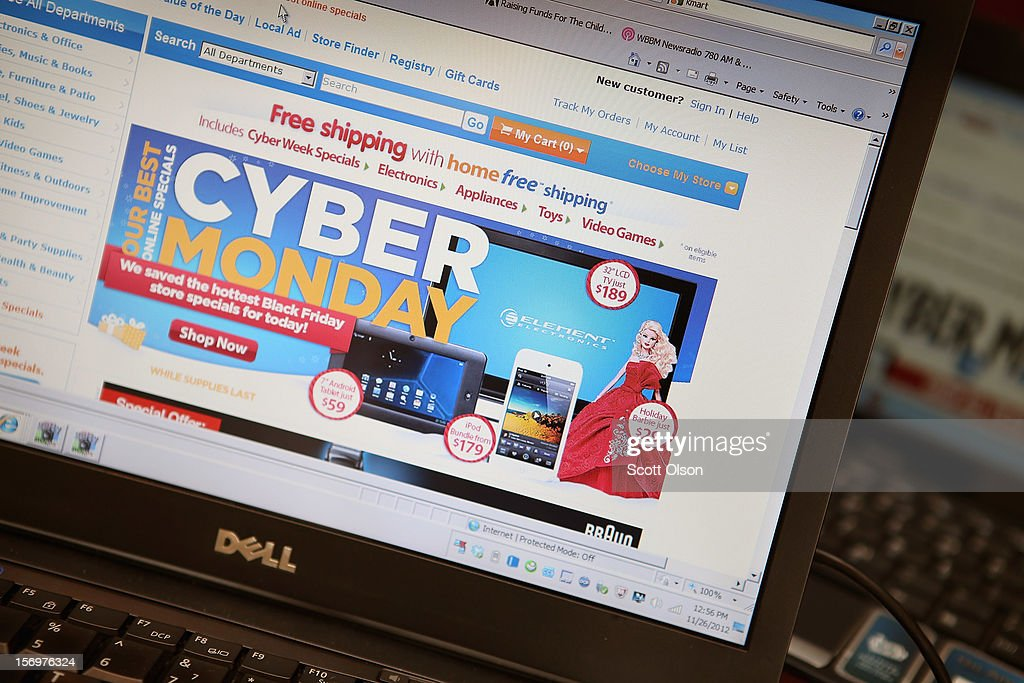 In this photo illustration, a retailer advertises Cyber Monday deals on their websites on November 26, 2012 in Chicago, Illinois. Americans are expected to spend $1.5 billion while shopping online today, up 20 percent from last year.
