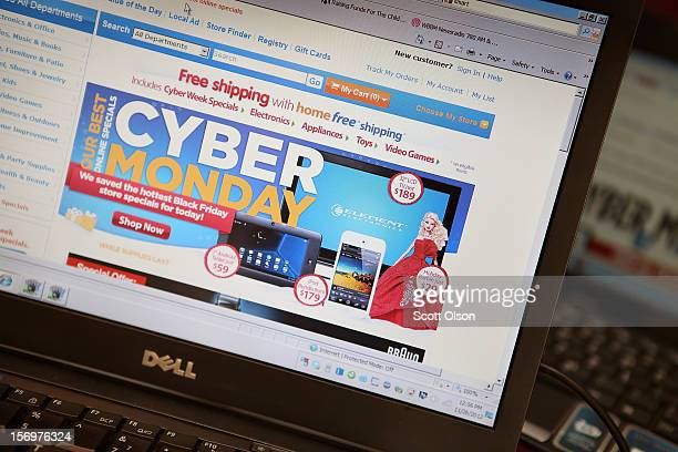 In this photo illustration, a retailer advertises Cyber Monday deals on their websites on November 26, 2012 in Chicago, Illinois. Americans are...