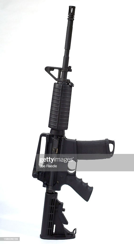 In this photo illustration a Rock River Arms AR-15 rifle is seen on December 18, 2012 in Miami, Florida. The weapon is similar in style to the Bushmaster AR-15 rifle that was used during a massacre at an elementary school in Newtown, Connecticut. Firearm sales have surged recently as speculation of stricter gun laws and a re-instatement of the assault weapons ban following the mass shooting.