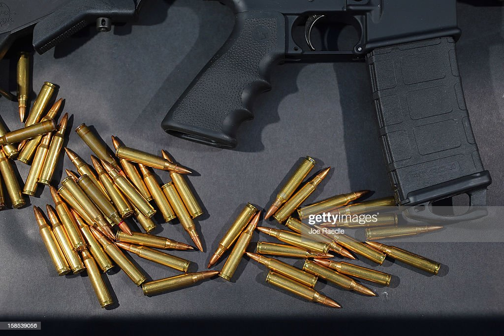 In this photo illustration, a Rock River Arms AR-15 rifle is seen with ammunition on December 18, 2012 in Miami, Florida. The weapon is similar in style to the Bushmaster AR-15 rifle that was used during a massacre at an elementary school in Newtown, Connecticut. Firearm sales have surged recently as speculation of stricter gun laws and a re-instatement of the assault weapons ban following the mass shooting.