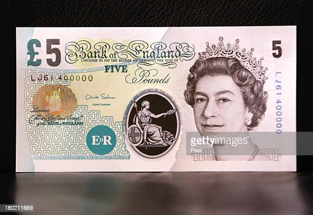 In this photo illustration a sample Polymer five pound British banknote sits on display during a news conference at the Bank of England on September...
