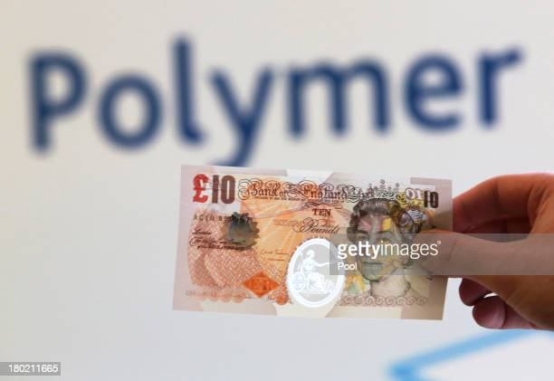 In this photo illustration a sample Polymer ten pound British banknote is held during a news conference at the Bank of England on September 10 2013...