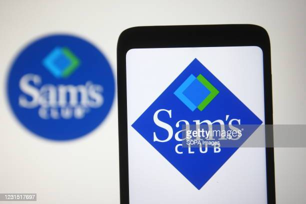 In this photo illustration a Sam's Club logo of a US chain of membership-only retail warehouse clubs is seen on a smartphone and a pc screen.