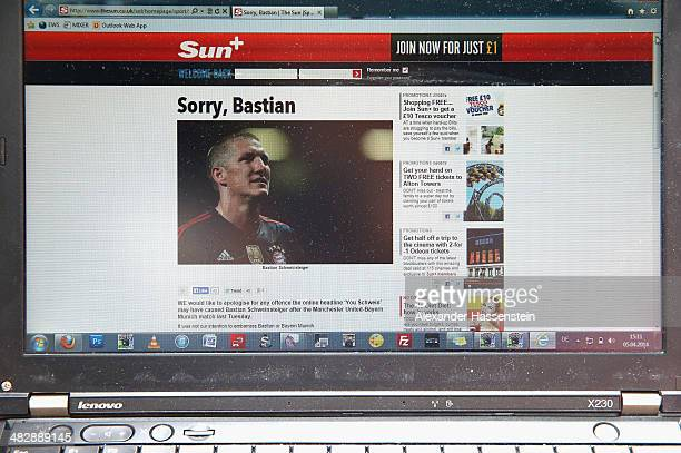 In this photo illustration a screen displays the website of English newspaper The Sun publishing an article to apologize for their comments about...