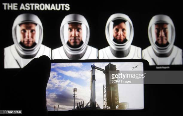 In this photo illustration a screenshot of the webcast NASA SpaceX Crew-1 mission launch is seen on a smartphone screen. NASA and SpaceX launched...
