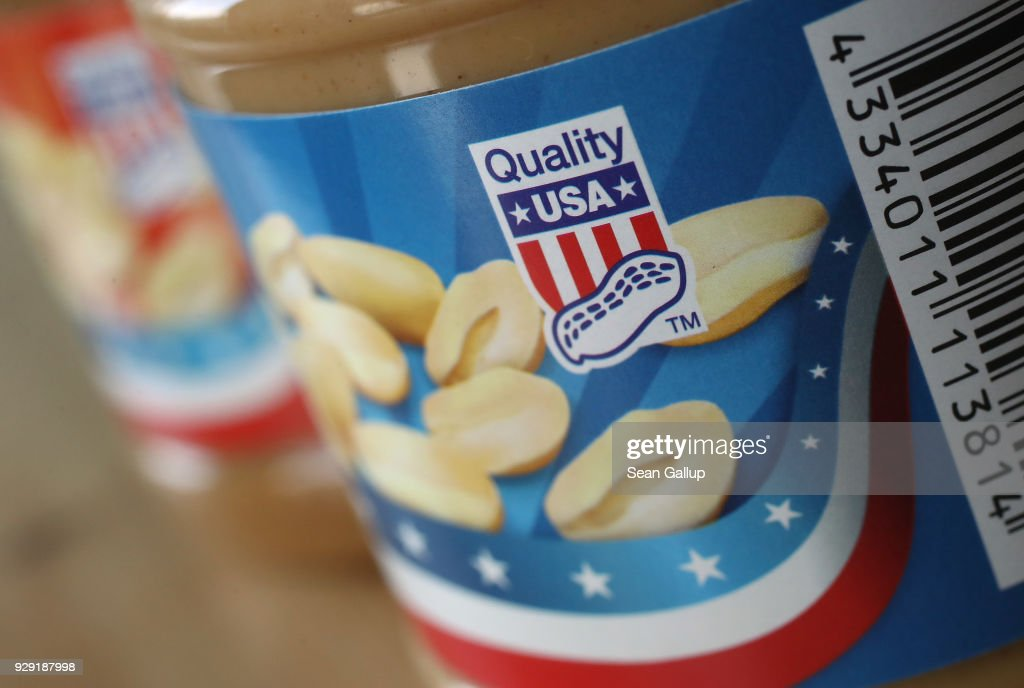 In this photo illustration a seal that reads: 'Quality USA' is seen on a jar of American peanut butter bought at a German supermakret on March 8, 2018 in Berlin, Germany. U.S. President Donald Trump has promised to authorize tariffs on imported steel and aluminum today and the European Commission has vowed to retaliate with tariffs on Levi's jeans, Kentucky bourbon and Harley-Davidson motorcycles, as well as peanut butter, cranberries, kidney beans, bed linens and lipstick. Many analysts fear the tariffs could escalate and hence cost jobs on both sides of the Atlantic. The European Union and Canada are the world's biggest exporters of steel to the United States.