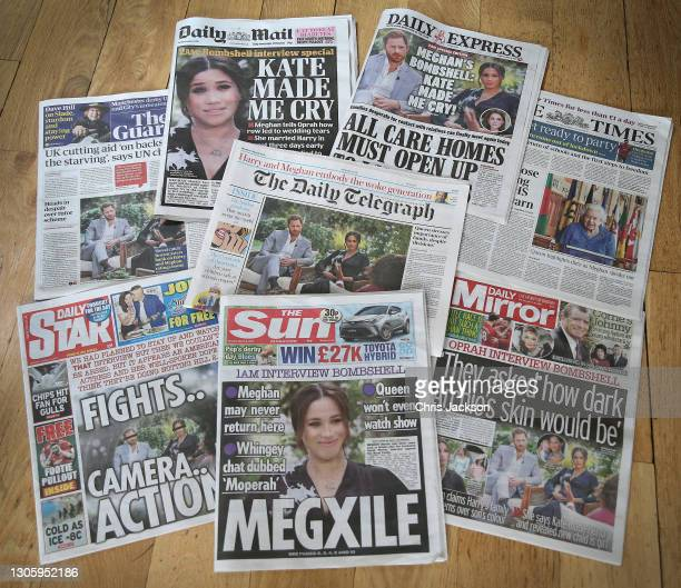 In this photo illustration - a selection of British newspaper publications in response to the Meghan, Duchess of Sussex and Prince Harry, Duke of...