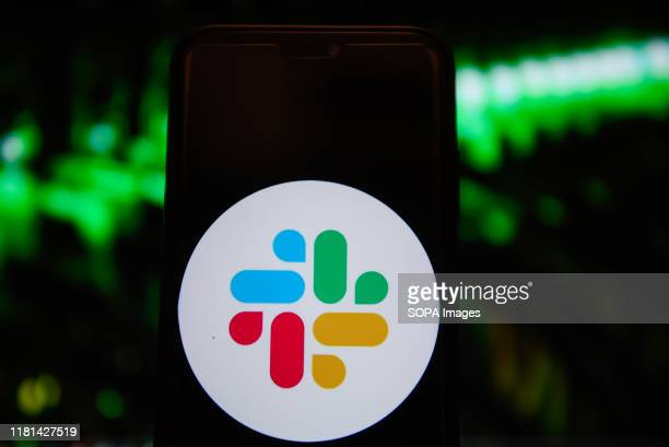 In this photo illustration a Slack logo displayed on a smartphone.