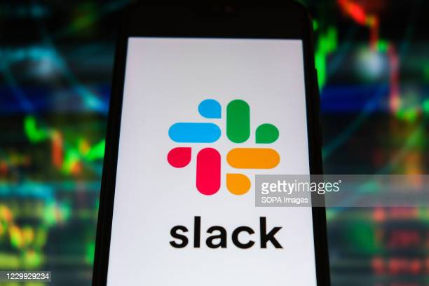 In this photo illustration a Slack logo is displayed on a smartphone with stock market graphics on the background.