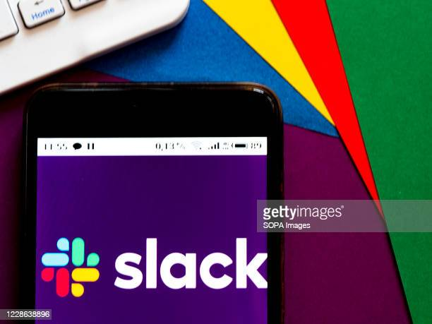 In this photo illustration a Slack logo seen displayed on a smartphone.
