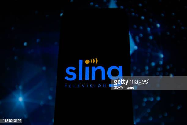 In this photo illustration a sling TV logo seen displayed on a smartphone.