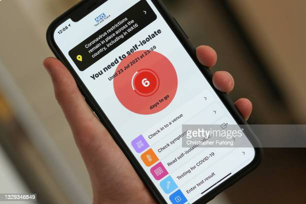 """In this photo illustration a smartphone using the NHS Covid-19 app alerts the user """"You need to self-isolate"""" on July 18, 2021 in Knutsford, England...."""