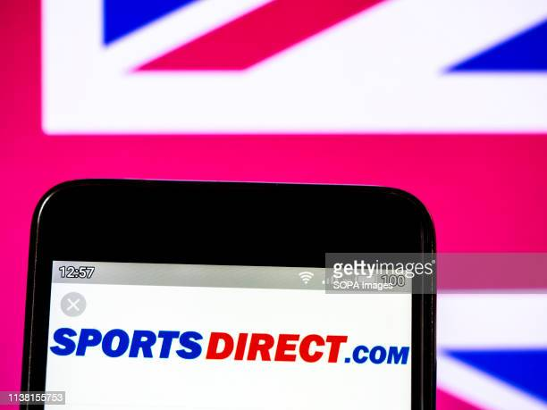 In this photo illustration a Sports Direct International plc logo seen displayed on a smartphone