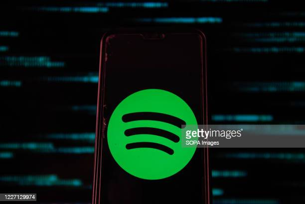 In this photo illustration a Spotify logo is seen displayed on a smartphone.