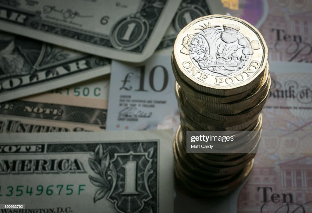 In this photo illustration, a stack of £1 coins is seen with the new £10 note alongside euro notes and US dollar bills on October 13, 2017 in Bath, England. Currency experts have warned that as the uncertainty surrounding Brexit continues, the value of the British pound, which has remained depressed against the US dollar and the euro since the UK voted to leave in the EU referendum, is likely to fluctuate.