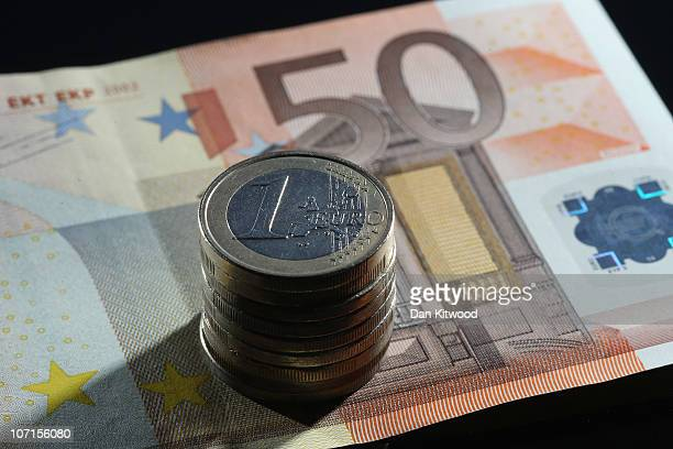 In this photo illustration a stack of Euro coins sit on top of a 50 Euro note on November 26 2010 in London England Concerns over the Euro zone debts...