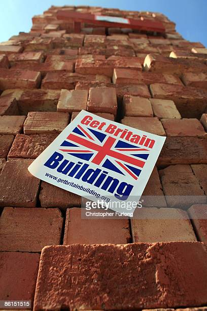 In this photo illustration a sticker given out at builders merchants to customers with the slogan 'Get Britain Building' adorns a stock pile of...