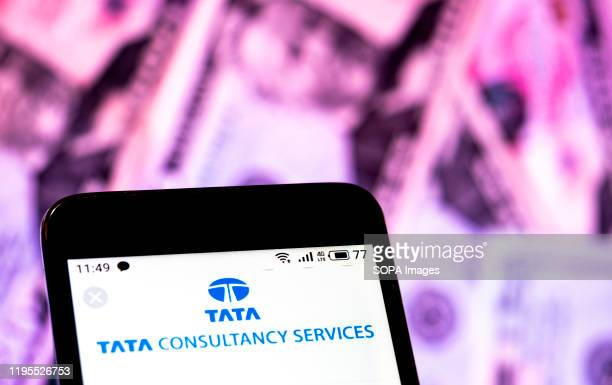 In this photo illustration a Tata Consultancy Services Limited logo seen displayed on a smartphone