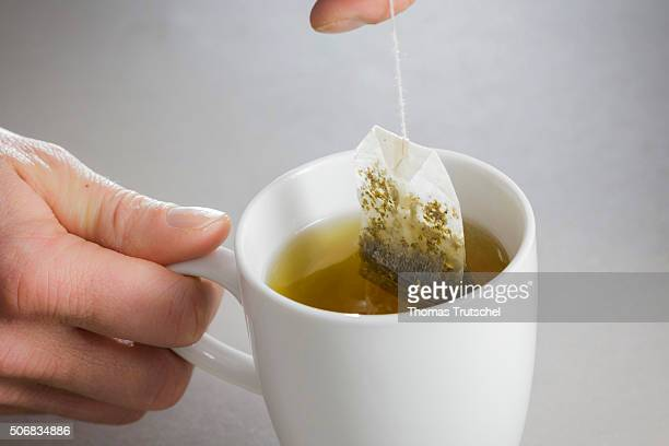 In this photo illustration a tea bag is brewed in a cup of hot water on January 26 2016 in Berlin Germany